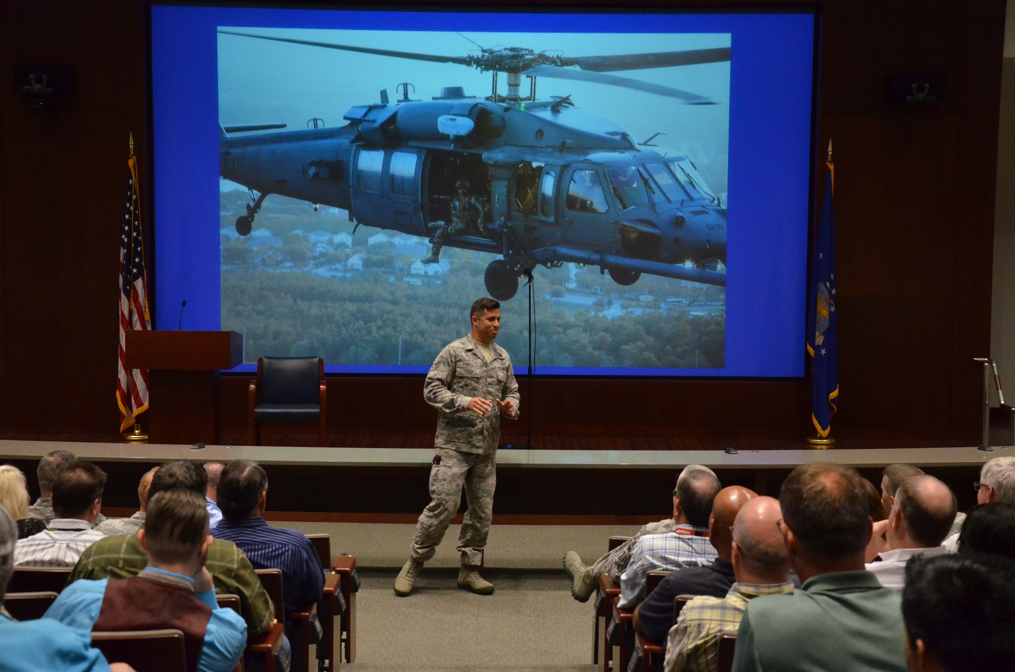 Staff Sgt. August O'Niell, an Air Force pararescueman, briefs members of the Air Force Technical Applications Center about how he sustained significant warzone injury, which led to the amputation of his leg, and how he overcame adversity during AFTAC's Combat Airman Fitness Day May 22, 2017.  O'Niell is the first Air Force pararescue amputee on active duty today. (U.S. Air Force photo by Susan A. Romano)