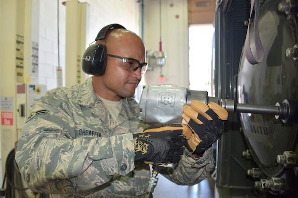 U.S. Air Force Airman 1st Class Jonathan Sheaffer, 161st Air Refueling wing vehicle maintenance apprentice, removes a bolt from a water separator filter on an R-11 refueling truck at Goldwater Air National Guard Base, May 3, 2017. The R-11 truck holds up to 6,000 gallons of fuel and is used to refuel the wing's KC-135 Stratotankers.