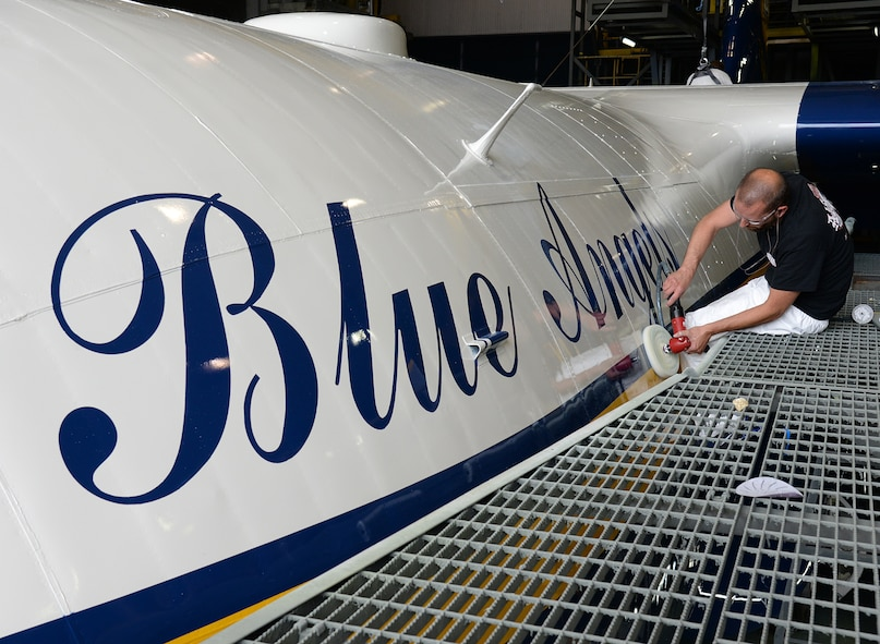 Using a buffer and wax, 576th Aircraft Maintenance Squadron aircraft painter Brandon Barney ensures Fat Albert  is shined and ready to roll out of the paint hangar on May 31 at Hill Air Force Base, Utah. (U.S. Air Force Photo by Alex R. Lloyd)