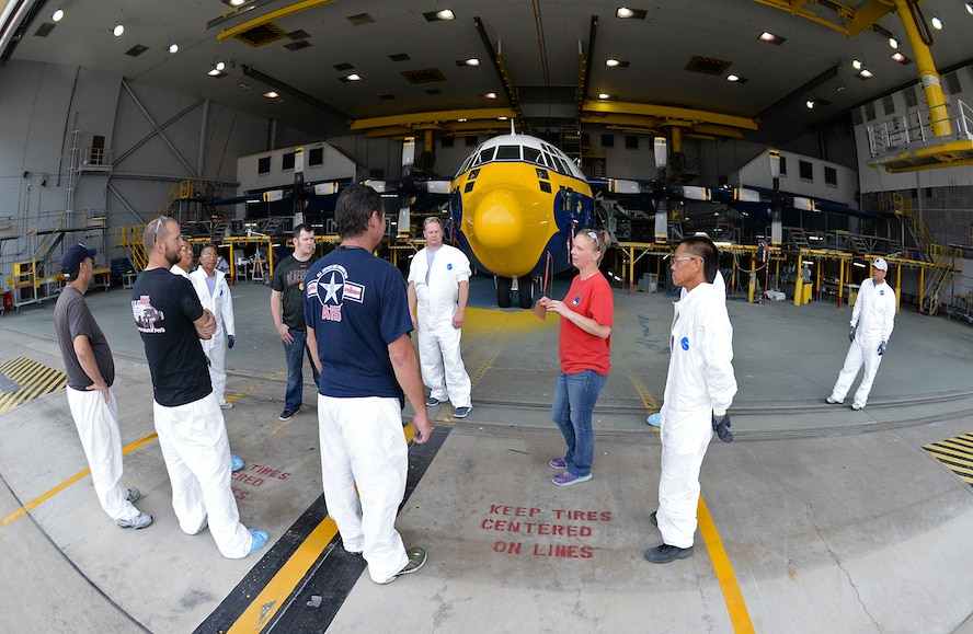 After all the hard work by both maintainers and painters, 576th Aircraft Maintenance Squadron wage leader Danielle Shaw (red shirt) assembles her crew for instructions before towing Fat Albert of the paint hangar on June 1 at Hill Air Force Base, Utah. The aircraft was towed to the 514th Flight Test Squadron for a shakedown flight to ensure all systems worked before being returned to the Blue Angels team. (U.S. Air Force Photo by Alex R. Lloyd)