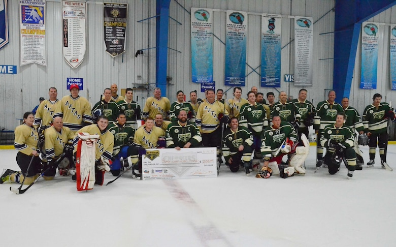 Players from the Air Force Technical Applications Center and the Brevard County Sheriff's Office pose for a group photo after the two teams competed in a charity game to raise money for the Space Coast Sled Hockey program June 10, 2017. (U.S. Air Force photo by Susan A. Romano)