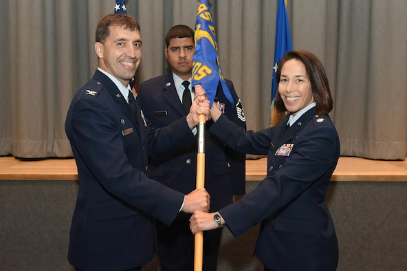 U.S. Air Force Lt. Col. Hayley James (right) assumes command of the 625th Strategic Operations Squadron (STOS) from U.S. Air Force Col. Robert Billings (left), commander of the 595th Command and Control Group, during a change of command ceremony at U.S. Strategic Command (USSTRATCOM) headquarters on Offutt Air Force Base, Neb., June 16, 2017. As commander of the 625th STOS, James leads an organization that executes and supports USSTRATCOM and Air Force Global Strike Command missions with continuous, rapid, accurate and survivable nuclear operations. Airmen from the 625th STOS serve on the U.S. Navy's E-6B Mercury aircraft to provide a survivable means to launch the nation's intercontinental ballistic missile force. James previously served as the 625th STOS director of operations before succeeding U.S. Air Force Lt. Col. Deane Konowicz as squadron commander. (U.S. Air Force photo by Staff Sgt. Jonathan Lovelady)