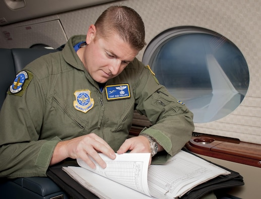 U.S. Air Force Tech. Sgt. Christopher Phillips, a communication systems operator assigned to the 310th Airlift Squadron, goes through a pre-flight inspection checklist before take-off at MacDill Air Force Base, Fla., May 5, 2017. During a pre-flight inspection, communication systems operators test the communications systems which will stay active for the rest of the flight. (U.S. Air Force photo by Airman 1st Class Mariette Adams)