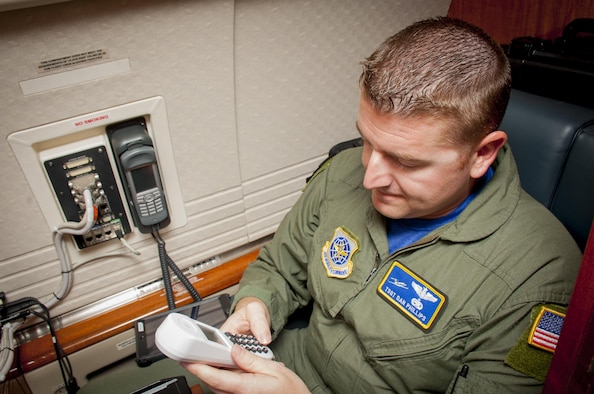 U.S. Air Force Tech. Sgt. Christopher Phillips, a communication systems operator assigned to the 310th Airlift Squadron, tests the phone systems during a pre-flight inspection at MacDill Air Force Base, Fla., May 5, 2017. Pre-flight inspections are done before every flight to ensure the aircraft is ready to fly. (U.S. Air Force photo by Airman 1st Class Mariette Adams)