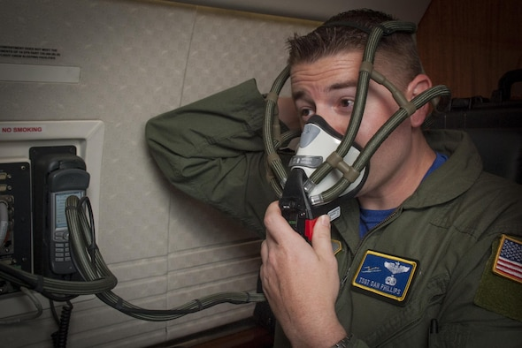 U.S. Air Force Tech. Sgt. Christopher Phillips, a communication systems operator assigned to the 310th Airlift Squadron, tests the oxygen system during a pre-flight inspection at MacDill Air Force Base, Fla., May 5, 2017. Pre-flight inspections are done before every flight to ensure the aircraft is ready for flight. (U.S. Air Force photo by Airman 1st Class Mariette Adams)