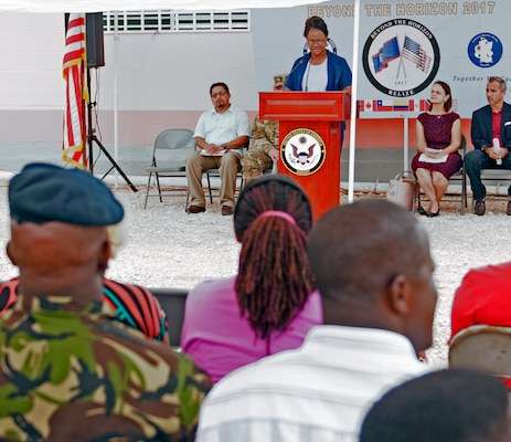 Nurse Sharon Espinoza, Ministry of Health nursing supervisor, speaks at the Ladyville Health Center ribbon-cutting ceremony June 9 in Ladyville, Belize. Construction of the building was completed as part of Beyond the Horizon 2017, a collaborative training exercise between U.S. Army South, the Belize Defence Force, other Central American nations and local and international NGOs, providing medical and engineering services throughout Belize. The new facility will more than double the capacity of the existing structure providing a wider range of availble medical options at the primary care level.