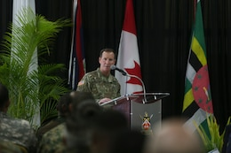 U.S. Army Lt. Gen. Joseph P. DiSalvo, the U.S. Southern Command military deputy commander, speaks to distinguished guests and service members from 20 nations during the closing ceremony for Phase II of Tradewinds 2017 in Chaguaramas, Trinidad and Tobago, June 17, 2017. The overall objective of Tradewinds, an annual exercise sponsored by SOUTHCOM, is to enhance the collective ability of the participating nations to conduct humanitarian assistance and disaster relief operations and counter transnational organized crime. U.S. Marines provided training and logistical support for Phase II of Tradewinds.