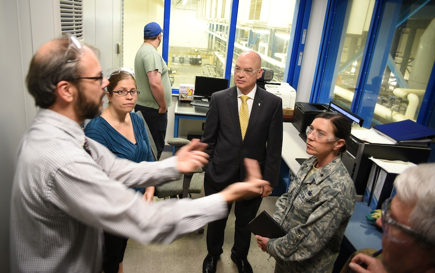 Lawrence Kingsley, deputy assistant secretary of the Air Force for Logistics and Product Support, Office of the Assistant Secretary of the Air Force for Acquisition, Headquarters, United States Air Force, center, receives an update on the 76th Propulsion Maintenance Group's Clean Line from engineers Richard Renfro, left, and Julie Marasco, during his visit to Tinker Air Force Base May 23-26. During his visit, Kingsley was provided with an overall understanding of the Air Force Sustainment Center mission, to include discussions on readiness challenges to the Air Force enterprise, workload, capabilities and innovation. The Clean Line briefing takes a look at the process flow of an engine to determine how infrastructure investment benefits AFSC efficiencies, quality and safety. Looking on is Brig. Gen. Linda Marsh, mobilization assistant to the AFSC commander. (Air Force photo by Darren D. Heusel)