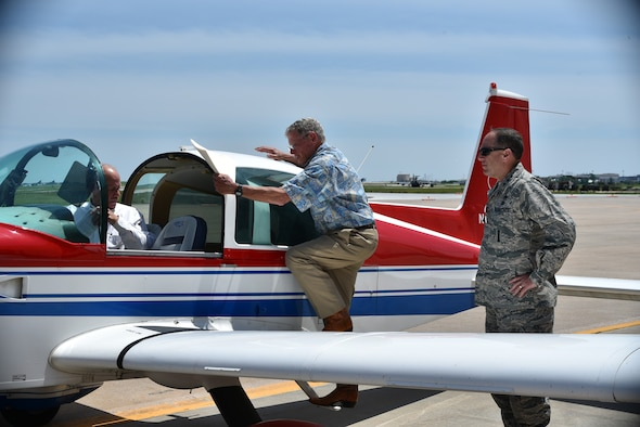 Lt. Gen. Lee K. Levy II, Air Force Sustainment Center commander, right, looks on as Sen. Jim Inhofe boards his airplane positioned in front of Base Ops following a brief visit to Tinker Air Force Base May 31. The senator was in the local area to attend a number of community events and received a quick tour of the base to discuss ongoing initiatives he's working on Capitol Hill. The Oklahoma senator and pilot occasionally flies his own plane, a Grumman Tiger, when conducting business at Tinker. (Air Force photo by Darren D. Heusel)