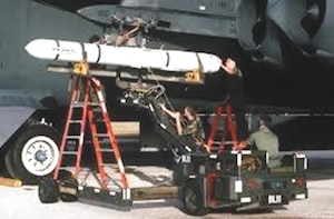 An AGM-84 Harpoon missile being loaded on a B-52. (Courtesy photo)
