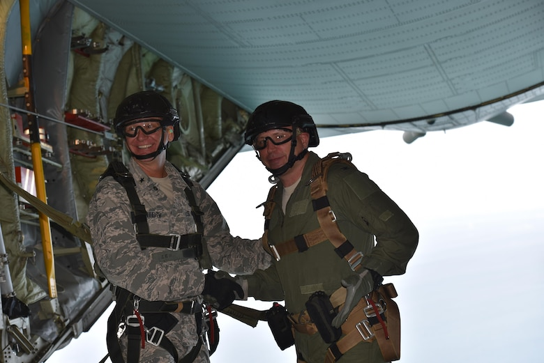 The 45th Space Wing Commander Brig. Gen. Wayne R. Monteith (left) and 920th Rescue Wing Commander Colonel Kurt A. Matthews, shake hands prior to tandem skydiving June 8, 2017, over Cape Canaveral Air Force Station, to demonstrate their wing's commitment to mutual-support and shared resources in an unforgettable way after signing a new host-tenant support agreement. (U.S. Air Force photo / Matthew Jurgens)