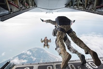 The 45th Space Wing Commander Brig. Gen. Wayne R. Monteith and 920th Rescue Wing Commander Colonel Kurt A. Matthews, tandem skydive June 8, 2017, over Cape Canaveral Air Force Station, to demonstrate their wing's commitment to mutual-support and shared resources in an unforgettable way after signing a new host-tenant support agreement. (U.S. Air Force photo / Matthew Jurgens)