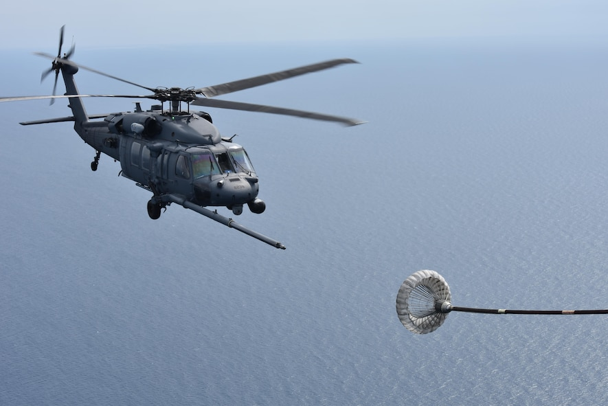 Airmen from the 920th Rescue Wing, Patrick Air Force Base, Florida, pilot an HH-60G Pave Hawk during an air-to-air refuel with a 920th HC-130P/N fixed-wing aircraft prior to a tandem jump by leaders from the HC-130 at both the both the 45th Space Wing and the 920th RQW, co-located at PAFB, to demonstrate their commitment to mutual-support and shared resources in an unforgettable way. (U.S. Air Force photo / Senior Airman Brandon Kalloo Sanes)