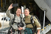 Brig. Gen. Wayne R. Monteith, 45th Space Wing commander, shoots a selfie with Chief Master Sgt. Mike Ziegler, pararescueman and senior enlisted member, 308th Rescue Squadron, June 8, 2017, prior to boarding a 920th Rescue Wing combat-search-and-rescue aircraft, where Ziegler will serve as the general's tandem jump master allowing him to skydive.  Leadership at both the 45th SW and the 920th RQW co-located at Patrick Air Force Base, Florida, agreed to demonstrate their commitment to mutual-support and shared resources in an unforgettable way. (U.S. Air Force photo / Senior Airman Brandon Kalloo Sanes)
