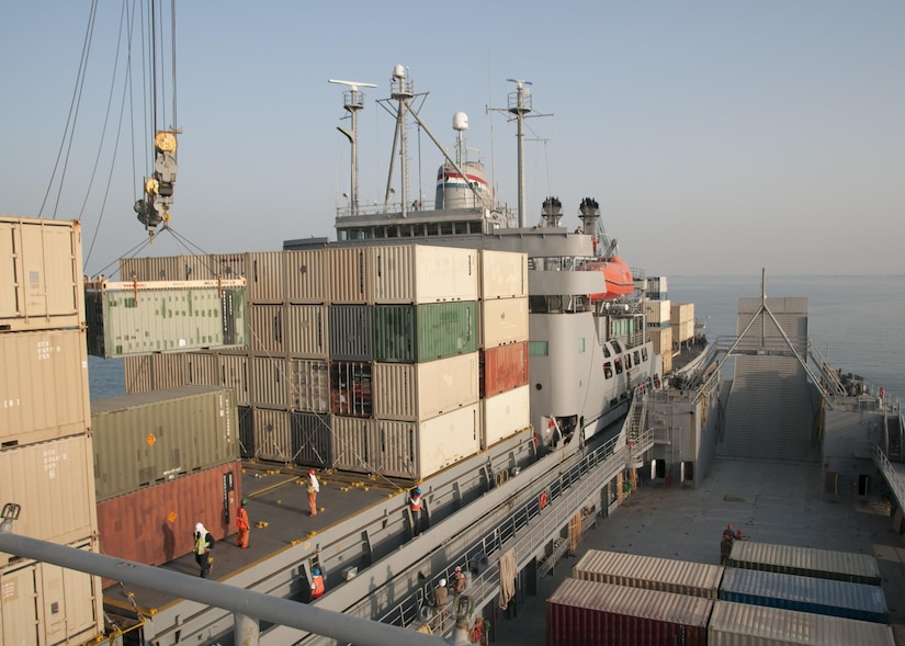 """The Military Sealift Command Vessel Gem State transfers a container to the U.S. Army Watercraft Logistics Support Vessel 5 (LSV-5), """"Maj. Gen. Charles P. Gross,"""" during an in-stream cargo transfer exercise in the Persian Gulf, on June 13, 2017. The vessels moved containers from one boat to the other using the Gem State's crane, in order to demonstrate the LSV's sustainment support capabilities. (U.S. Army photo by Sgt. Jeremy Bratt)"""