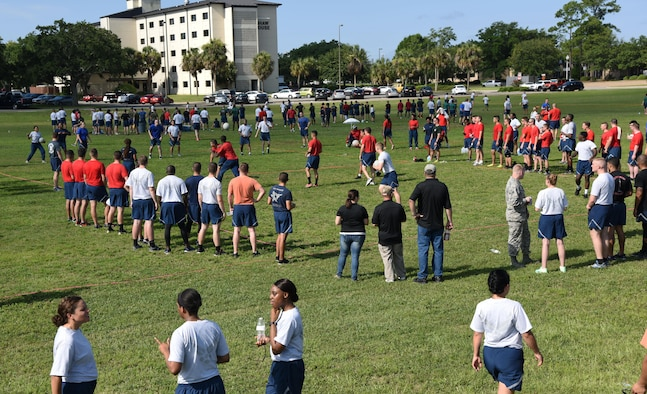 Keesler personnel gather to play competitive sports such as dodgeball and ultimate football during field day June 15, 2017, on Keesler Air Force Base, Miss. Field day was the final event of Wingman Week, which focused on the physical pillar of Comprehensive Airman Fitness, resiliency and teambuilding initiatives across the base. (U.S. Air Force photo by Kemberly Groue)