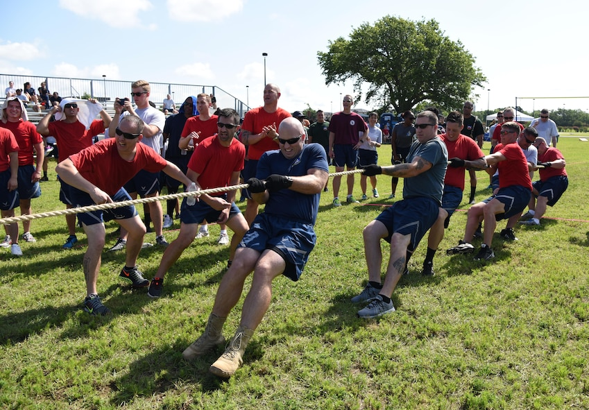 Members of the 81st Mission Support Group participate in a tug-of-war competition during field day June 15, 2017, on Keesler Air Force Base, Miss. Field day was the final event of Wingman Week, which focused on the physical pillar of Comprehensive Airman Fitness, resiliency and teambuilding initiatives across the base. (U.S. Air Force photo by Kemberly Groue)
