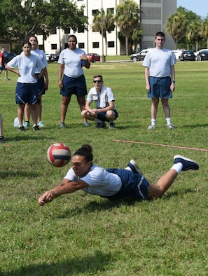 Airman 1st Class Aneesa Smith, 81st Medical Operations Squadron mental health technician, dives to hit the ball during a volleyball competition during field day June 15, 2017, on Keesler Air Force Base, Miss. Field day was the final event of Wingman Week, which focused on the physical pillar of Comprehensive Airman Fitness, resiliency and teambuilding initiatives across the base. (U.S. Air Force photo by Kemberly Groue)