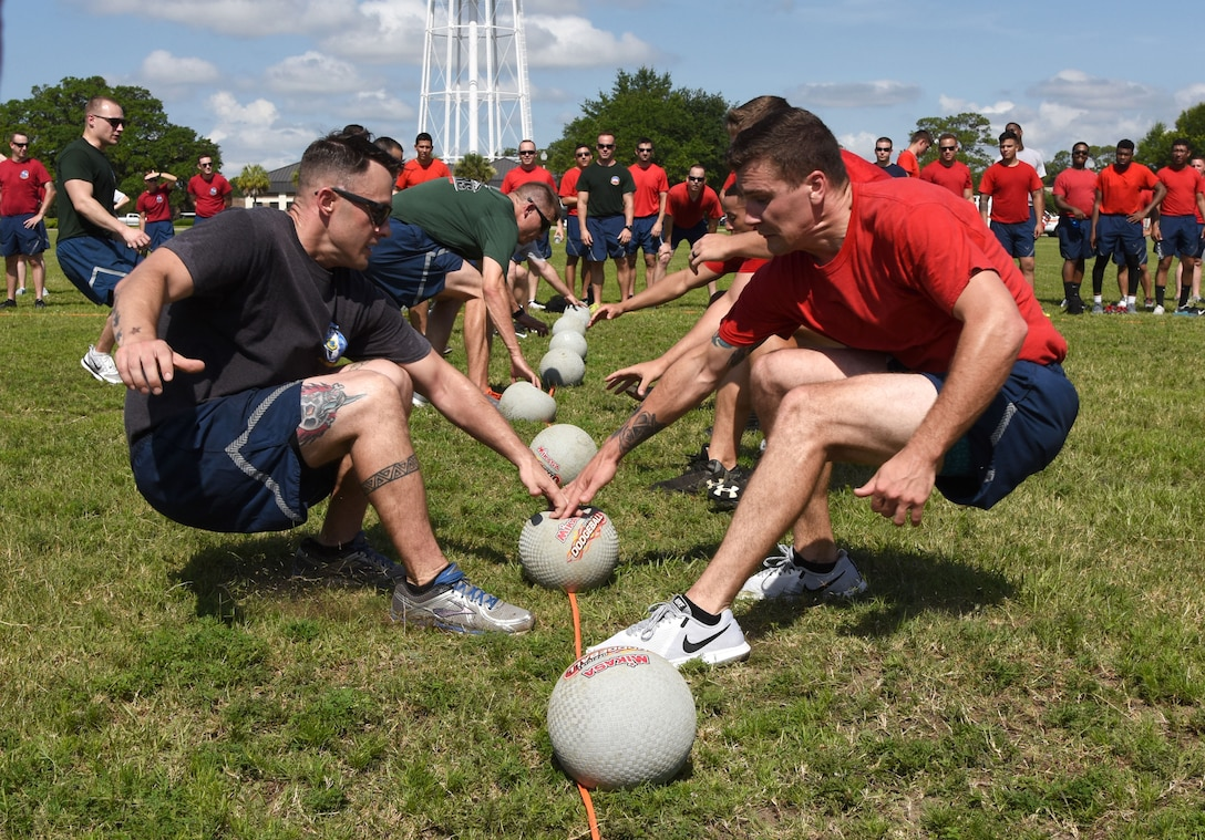 Members of the 81st Training Group and the 81st Mission Support Group participate in a dodgeball competition during field day June 15, 2017, on Keesler Air Force Base, Miss. Field day was the final event of Wingman Week, which focused on the physical pillar of Comprehensive Airman Fitness, resiliency and teambuilding initiatives across the base. (U.S. Air Force photo by Kemberly Groue)