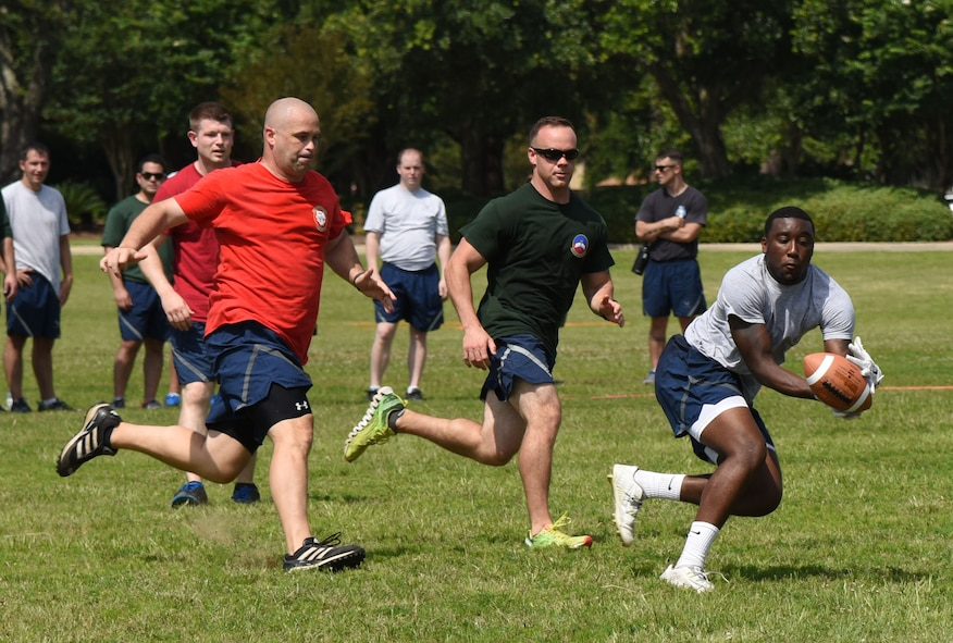 Airman Keshaun Survine, 81st Security Forces Squadron base defense operation center controller, catches the ball during an ultimate football competition during field day June 15, 2017, on Keesler Air Force Base, Miss. Field day was the final event of Wingman Week, which focused on the physical pillar of Comprehensive Airman Fitness, resiliency and teambuilding initiatives across the base. (U.S. Air Force photo by Kemberly Groue)