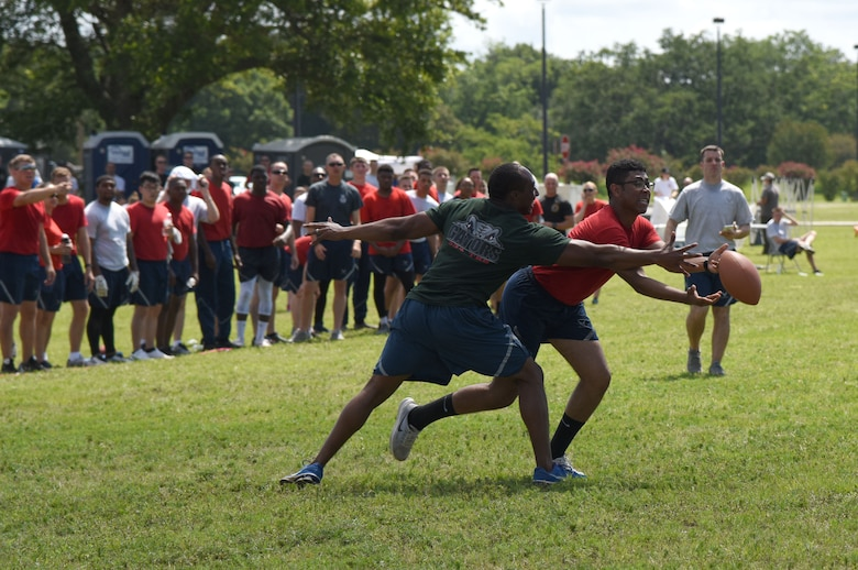 Senior Airman Cameron Spriggs, 81st Logistics Readiness Squadron logistics planner, catches the ball during an ultimate football competition during field day June 15, 2017, on Keesler Air Force Base, Miss. Field day was the final event of Wingman Week, which focused on the physical pillar of Comprehensive Airman Fitness, resiliency and teambuilding initiatives across the base. (U.S. Air Force photo by Kemberly Groue)