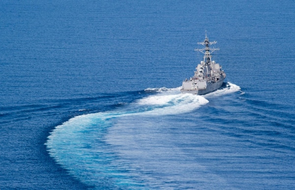 In this file photo, the Arleigh Burke-class guided-missile destroyer USS Dewey (DDG 105) transits the South China Sea. Dewey is part of the Sterett-Dewey Surface Action Group and is the third deploying group operating under the command and control construct called 3rd Fleet Forward, May 27, 2017. The U.S. 3rd Fleet operating forward offers additional options to the Pacific Fleet commander by leveraging the capabilities of 3rd and 7th Fleets.
