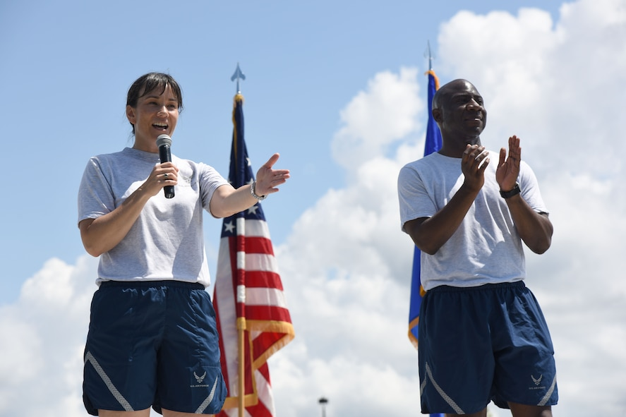Col. Debra Lovette, 81st Training Wing commander, delivers remarks as Chief Master Sgt. Vegas Clark, 81st TRW command chief, stands by during field day June 15, 2017, on Keesler Air Force Base, Miss. Field day was the final event of Wingman Week, which focused on the physical pillar of Comprehensive Airman Fitness, resiliency and teambuilding initiatives across the base. (U.S. Air Force photo by Kemberly Groue)