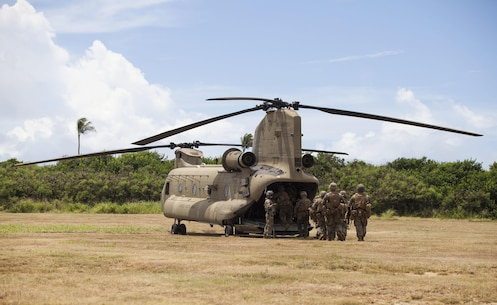 MARINE CORPS BASE HAWAII – Marines with Lima Company, 3rd Battalion, 3rd Marine Regiment, enter a CH-47 Chinook helicopter assigned to the 25th Combat Aviation Brigade prior to conducting Exercise Bougainville 1-17.2 at Landing Zone Boondocker aboard Marine Corps Base Hawaii, June 14, 2017. The 25th Combat Aviation Brigade supported the Marines during an air assault taking place at the Kahuku Training area that is part of Exercise Bougainville, a two week training exercise for the battalion to enhance their lethality and effectiveness as a force in readiness. (U.S. Marine Corps photo by Cpl. Jesus Sepulveda Torres)