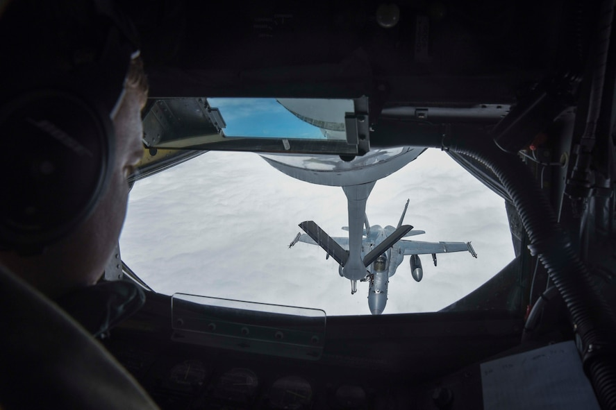 Senior Airman Jeffrey Jaskela, 350th Air Refueling Squadron boom operator, refuels an F-18 Hornet, above Canada, during Red Flag-Alaska 17-2, June 12, 2017. Four McConnell aircrew took two KC-135 Stratotankers to Eielson Air Force Base, Alaska, to provide warfighting support during the two-week exercise. (U.S. Air Force photo/Senior Airman Chris Thornbury)