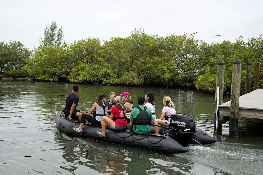 Spouses from Special Operations Command Central ride on a Zodiac, an inflatable boat, as part of Spartan Spouse Day held at MacDill Air Force Base, Fla., June 13, 2017. The day included inflatable-boat familiarization as an opportunity to experience the training their spouses have gone through. (U.S. Air Force photo by Airman 1st Class Caleb Nunez)