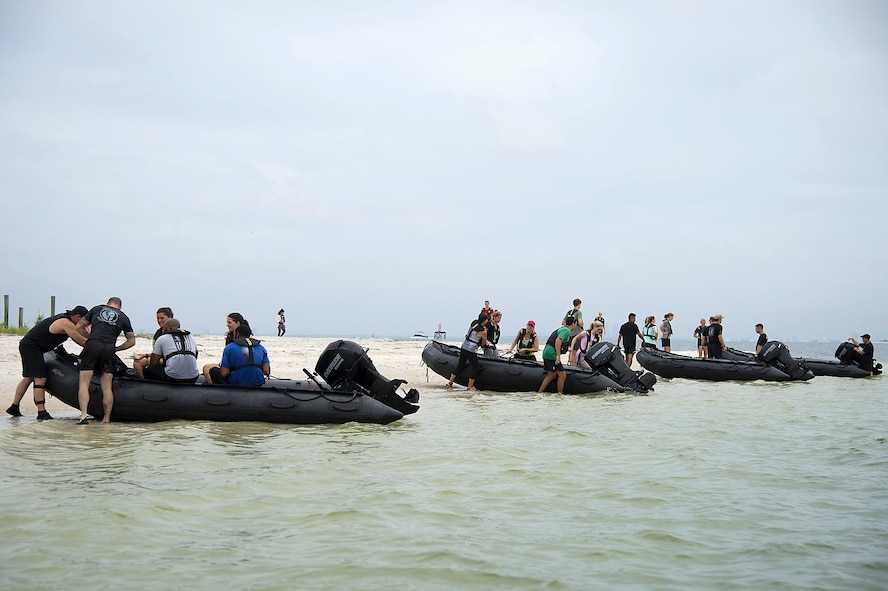 Spouses from Special Operations Command Central arrive on the shore of Pine Key, Fla., as part of Spartan Spouse Day, June 13, 2017. The spouses learned how to mount and dismount Zodiac inflatable boats and their use in special operation missions. (U.S. Air Force photo by Airman 1st Class Caleb Nunez)