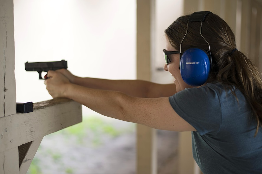 Christie Patterson, the wife of a Special Operations Command Central service member, fires a handgun as part of the Spartan Spouse Day held at MacDill Air Force Base, Fla., June 13, 2017. Spartan Spouse day allowed spouses to receive first-hand experience of what takes place within the special operations community. (U.S. Air Force photo by Airman 1st Class Caleb Nunez)