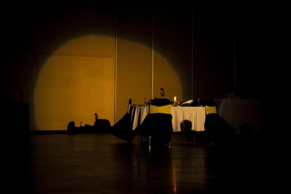 Prisoner of War, Missing in Action table spotlighted during a moment of silence for the remembrance ceremony during the Army Ball at the McNease Convention Center San Angelo, Texas, July 16, 2017. At the beginning of most military ceremonies, the POW/MIA table is given a moment of silence to remember those who are yet unaccounted for from past armed conflicts. (U.S. Air Force photo by Senior Airman Scott Jackson/Released)