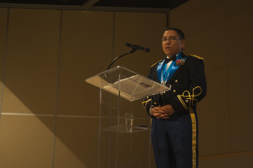 U.S. Army Lt. Col. Yukio Kuniyuki, 344th Military Intelligence Battalion Commander, gives remarks during the Army Ball at the McNease Convention Center San Angelo, Texas, June 16, 2017. Kuniyuki spoke on how important the heritage of the Army is and how far the force has come since its founding. (U.S. Air Force photo by Senior Airman Scott Jackson/Released)