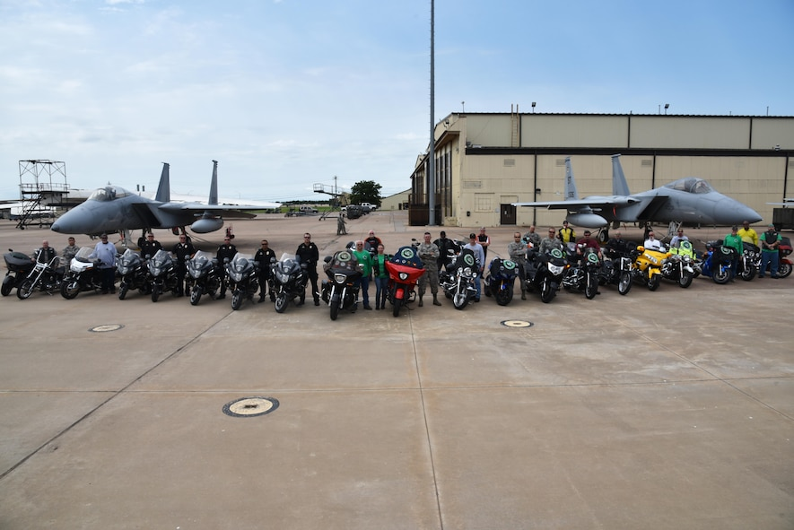 Chapter 54 of the Green Knights Military Motorcycle Club, Wichita Falls police officers and motorcyclists from Team Sheppard gather in front of two F-15 Strike Eagles, June 19, 2017. The GKMMC and the Sheppard safety office work together to educate new riders on base. (U.S. Air Force photo by 2nd Lt. Jacqueline Jastrzebski)