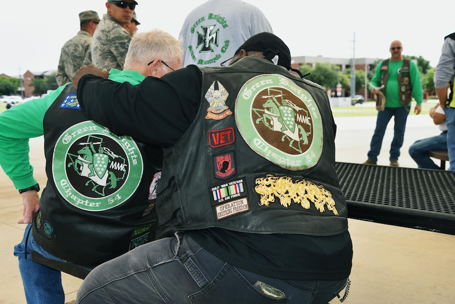 Members of the Green Knights Military Motorcycle Club listen to a safety brief before the Motorcycle Awareness Ride through base, June 19, 2017. GKMMC members proudly display patches and rank on their vests from their time in service. (U.S. Air Force photo by 2nd Lt. Jacqueline Jastrzebski)