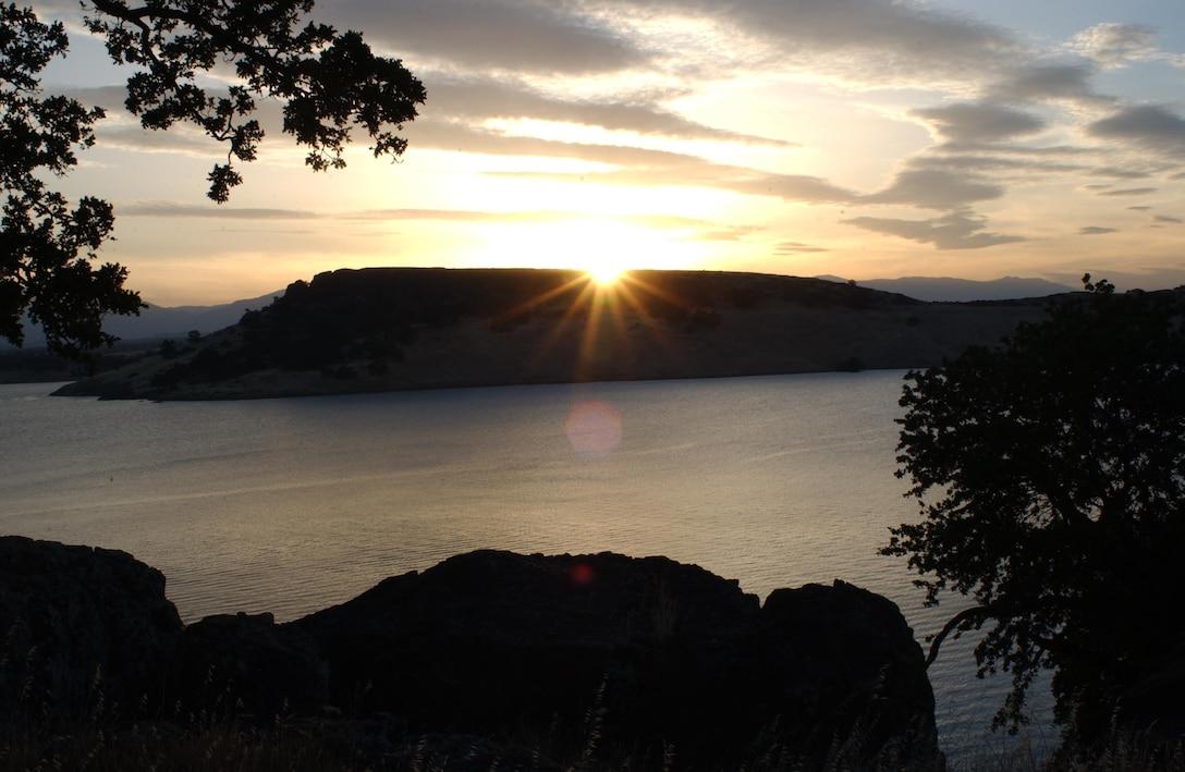 The sun sets over scenic Black Butte Lake