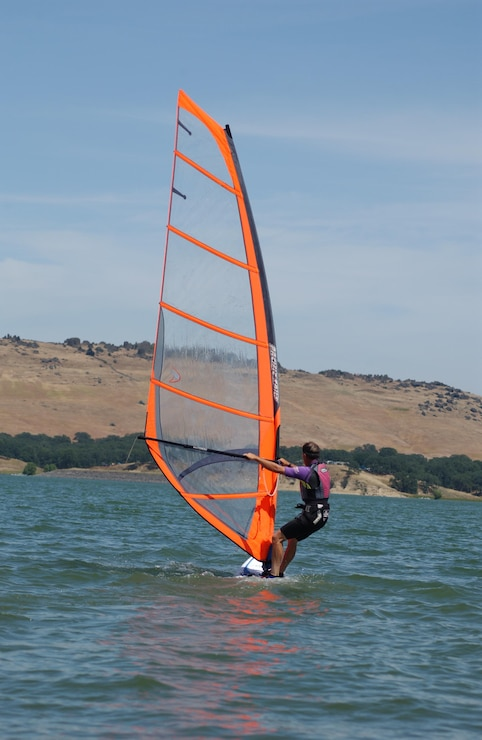 A wind-surfer heads out to catch an afternoon breeze on Black Butte Lake.