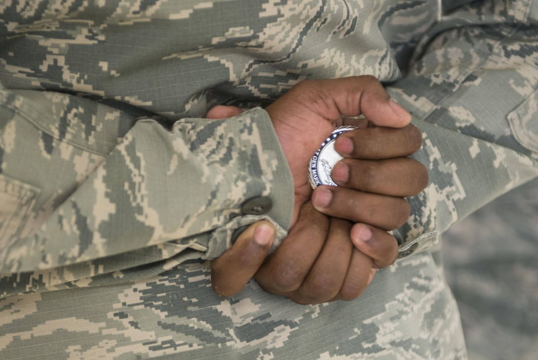 Tech. Sgt. Freddy Rengifo, 366th Medical Group women's health flight chief, holds the coin he recieved from Lt. Gen. Mark Ediger, Air Force Surgeon General, June 14, 2017, at Mountain Home Air Force Base. Ediger coined high performers at the medical group during his visit. (U.S. Air Force photo by Senior Airman Malissa Lott/Released)