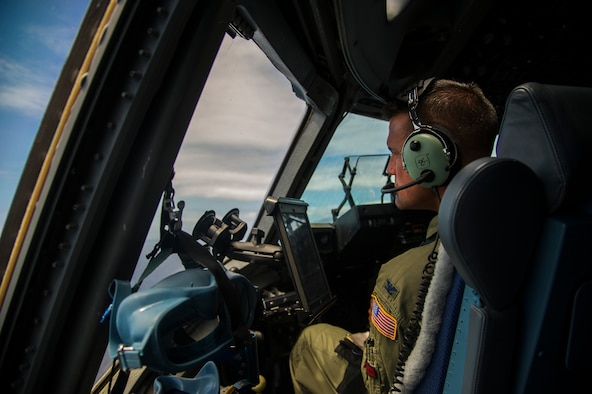 Col. Charles Velino, 15th Operations Group commander, flies a C-17 Globemaster III over the Hawaiian Islands during his final flight, June 16, 2017.  Velino is a command pilot with over 3,500 flying hours and will be leaving the 15th Operations Group to take command of the 47th Flying Training Wing in Laughlin AFB, Texas. (U.S. Air Force photo by Tech Sgt. Heather Redman)