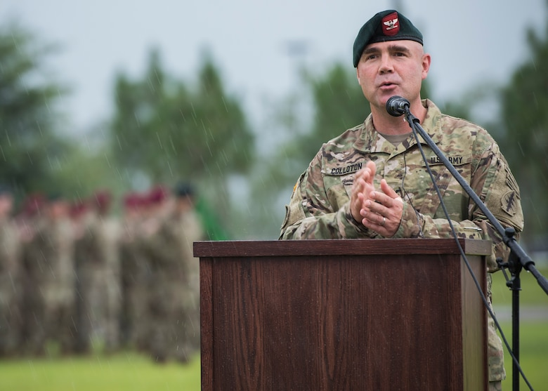 U.S. Army Col. Patrick Colloton, incoming commander, 7th Special Forces Group (Airborne), addresses the audience during a Florida thunderstorm at a change of command ceremony June 15 at Eglin Air Force Base, Fla. During the ceremony Col. Michael Ball relinquished command of the 7th SFG(A) to Col. Patrick Colloton. Colloton previously served as the 7th SFG(A) 1st Battalion commander. (U.S. Air Force photo/Ilka Cole)