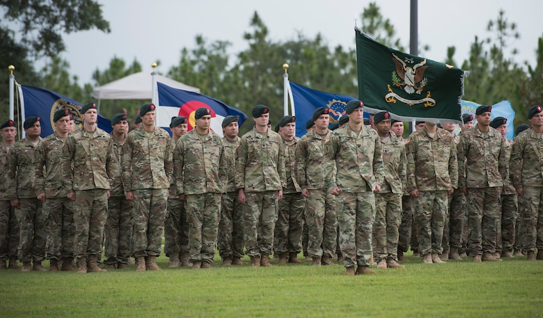 Green Berets from the 7th Special Forces Group (Airborne) stand at attention during a change of command ceremony June 15 at Eglin Air Force Base, Fla. During the ceremony Col. Michael Ball relinquished command of the 7th SFG(A) to Col. Patrick Colloton. Colloton previously served as the 7th SFG(A) 1 st Battalion commander. (U.S. Air Force photo/Ilka Cole)