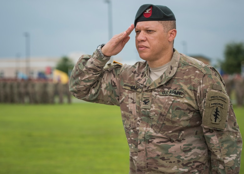 U.S. Army Col. Michael Ball, 7th Special Forces Group (Airborne) outgoing commander, salutes during a change of command ceremony June 15 at Eglin Air Force Base, Fla. During the ceremony Col. Michael Ball relinquished command of the 7th SFG(A) to Col. Patrick Colloton. Colloton previously served as the 7th SFG(A) 1st Battalion commander. (U.S. Air Force photo/Ilka Cole)