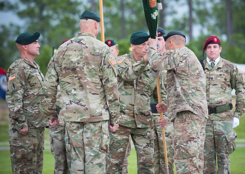 U.S. Army Command Sgt. Major Mark Thibeau, 7th Special Forces Group (Airborne), passes the Group colors to Col. Michael Ball, the outgoing commander, during a change of command ceremony June 15 at Eglin Air Force Base, Fla. During the ceremony Col. Michael Ball relinquished command of the 7th SFG(A) to Col. Patrick Colloton. The passing of the Group's colors marks the change of command. (U.S. Air Force photo/Ilka Cole)