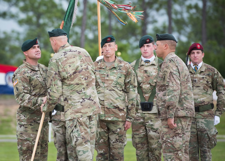 U.S. Army Col. Patrick Colloton, incoming commander, accepts command of the 7th Special Forces Group (Airborne) from Brig. Gen. Edwin J. Deedrick,commanding general 1st Special Forces Command (Airborne) as CSM Mark Thibeau and Col. Michael Ball, outgoing commander look on during a change of command ceremony June 15 at Eglin Air Force Base, Fla. During the ceremony Col. Michael Ball relinquished command of the 7th SFG(A) to Col. Patrick Colloton. The passing of the Group's colors marks the change of command. (U.S. Air Force photo/Ilka Cole)