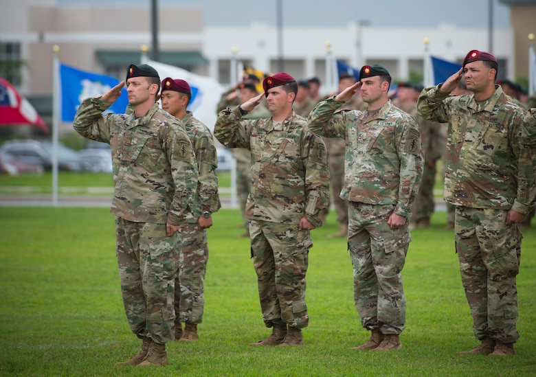 Soldiers of the 7th Special Forces Group (Airborne) salute during a change of command ceremony June 15 at Eglin Air Force Base, Fla. During the ceremony Col. Michael Ball relinquished command of the 7th SFG(A) to Col. Patrick Colloton. Colloton previously served as the 7th SFG(A) 1st Battalion commander. (U.S. Air Force photo/Ilka Cole)