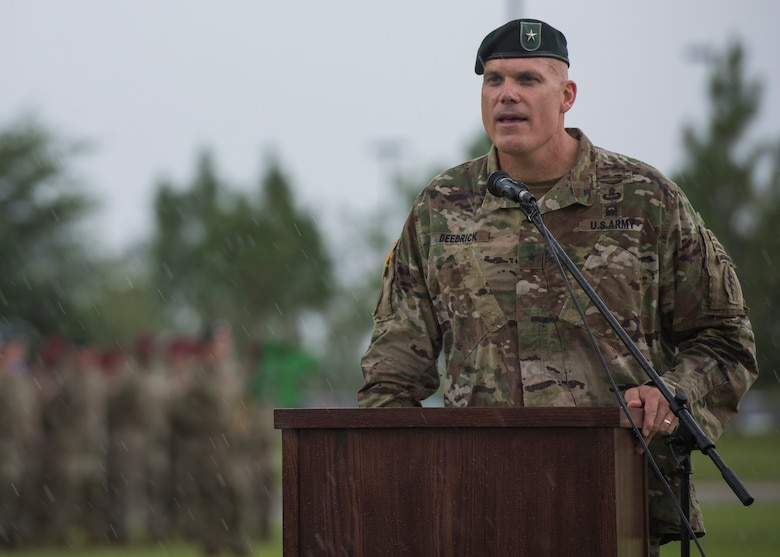 U.S. Army Brig. Gen. Edwin J. Deedrick, commanding general 1st Special Forces Command (Airborne) addresses the audience during a Florida thunderstorm at a change of command ceremony June 15 at Eglin Air Force Base, Fla. During the ceremony Col. Michael Ball relinquished command of the 7th SFG(A) to Col. Patrick Colloton. (U.S. Air Force photo/Ilka Cole)