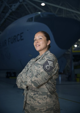 Master Sgt. Josette Wheeler, Knowledge Operations Specialist, 914th Maintenance Squadron, stands in front of a KC-135 Stratotanker in an aircraft hangar. MSgt. Wheeler is a proud member of the 914th, the American Legion and the Six Nations. (U.S. Air Force photo by Tech. Sgt. Stephanie Sawyer)
