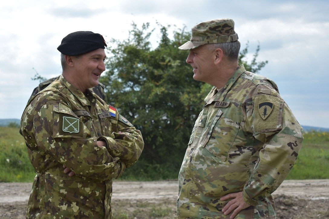 Brig. Gen. Gheorghita Vlad, Commander of Joint National Training Center, and Brig. Gen. Phillip Jolly, United States Army Europe, Deputy Commanding General for Mobilization and Reserve Affairs, United States Army Europe, discuss the construction projects at JNTC, Cincu, Romania. U.S., U.K., and Romanian engineers are building a non-standard live-fire range, breaching and demolitions range. Resolute Castle 2017 is an exercise strengthening the NATO alliance and enhancing its capacity for joint training and response to threats within the region.