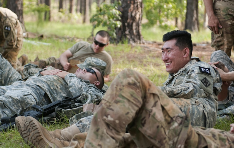 Spc. Wantae Seong (right), a carpentry and masonry specialist representing the 412th Theater Engineer Command, rests between events during the 2017 U.S. Army Reserve Best Warrior Competition at Fort Bragg, N.C. June 14. This year's Best Warrior Competition will determine the top noncommissioned officer and junior enlisted Soldier who will represent the U.S. Army Reserve in the Department of the Army Best Warrior Competition later this year at Fort A.P. Hill, Va. (U.S. Army Reserve photo by Sgt. David Turner) (Released)